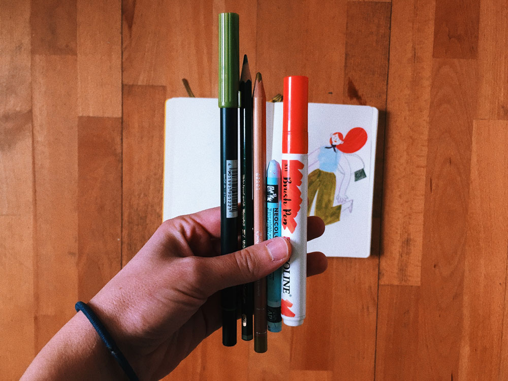 pens and sketchbook